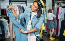 african american hipster girl choosing clothes