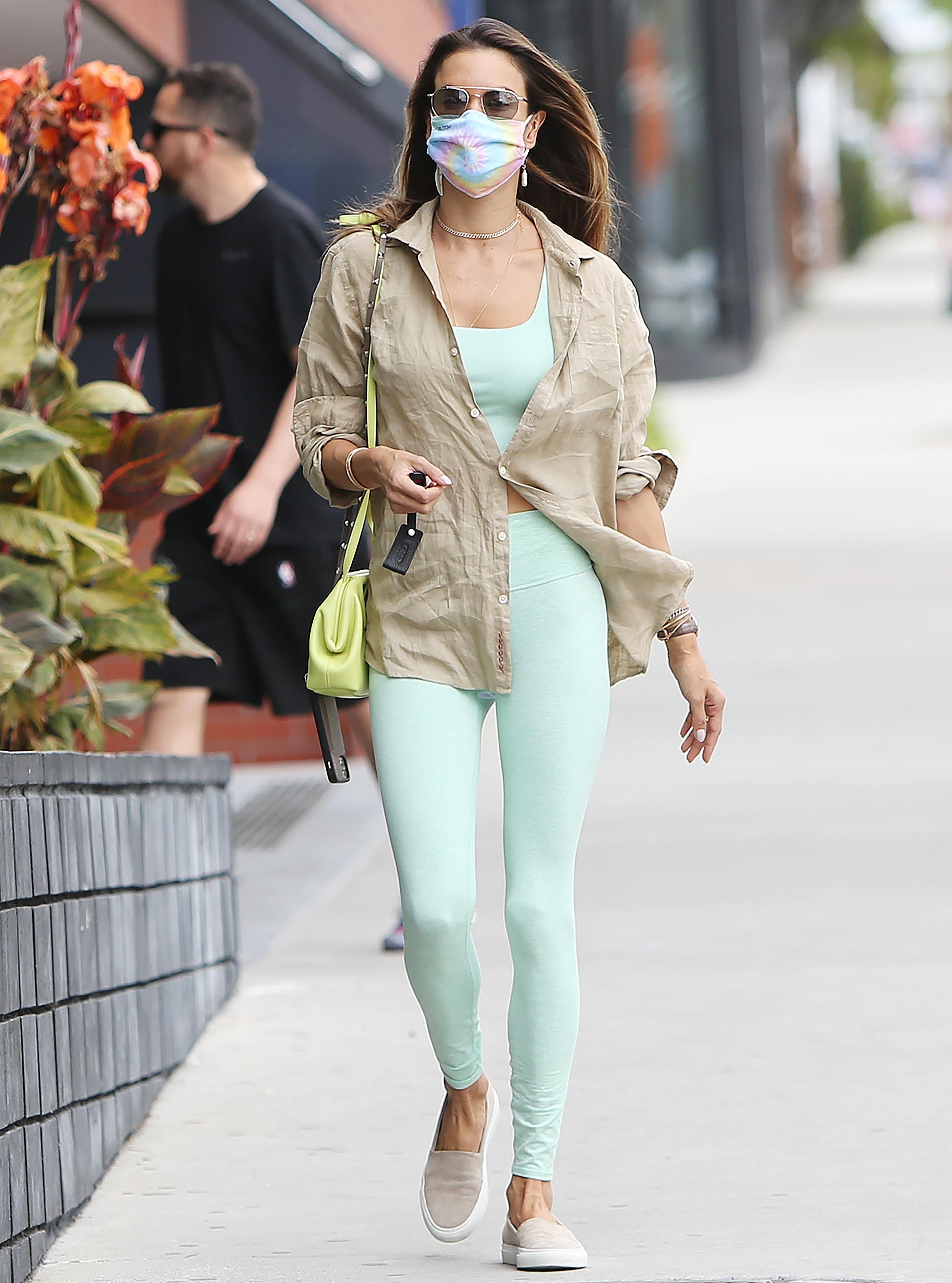 Alessandra Ambrosio spotted in green leggings as she run errands in Santa Monica. 01 Apr 2021 Pictured: Alessandra Ambrosio. Photo credit: CrownMedia/MEGA TheMegaAgency.com +1 888 505 6342 (Mega Agency TagID: MEGA743894_004.jpg) [Photo via Mega Agency]