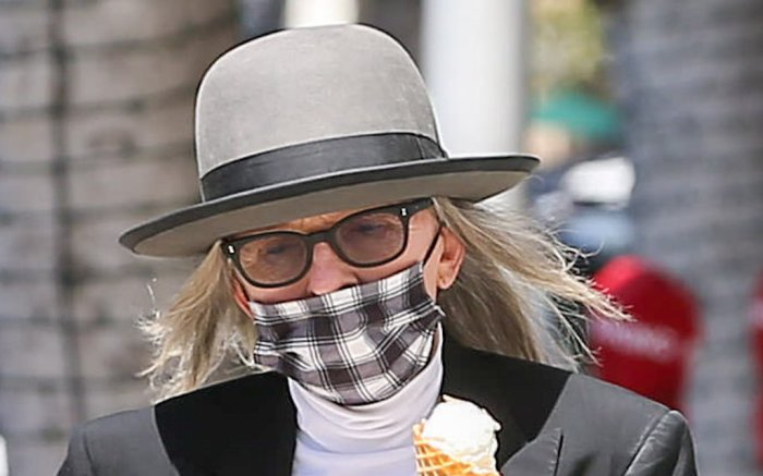 Diane Keaton grabs a ice cream while wearing a mask