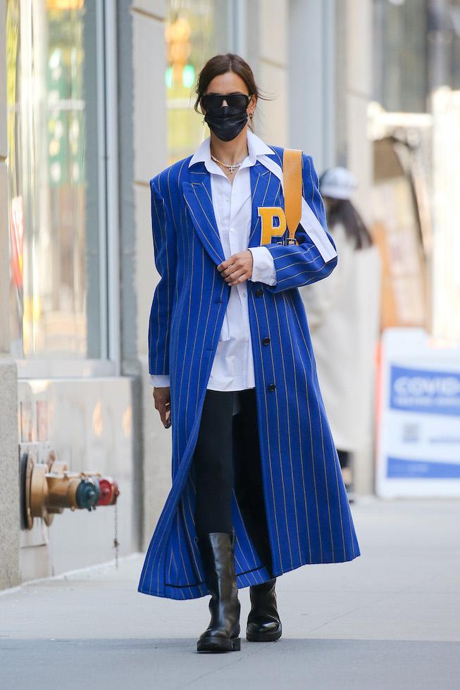Irina Shayk looks stylish in a striped coat as walking around in the west village in NYC. 19 Apr 2021 Pictured: Irina Shayk. Photo credit: MEGA TheMegaAgency.com +1 888 505 6342 (Mega Agency TagID: MEGA747755_006.jpg) [Photo via Mega Agency]