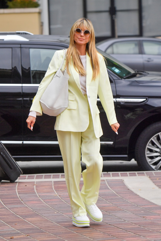 Heidi Klum wears a monochromatic pastel yellow outfit as she makes her way into AGT Pictured: Heidi Klum Ref: SPL5223241 230421 NON-EXCLUSIVE Picture by: SplashNews.com Splash News and Pictures USA: +1 310-525-5808 London: +44 (0)20 8126 1009 Berlin: +49 175 3764 166 photodesk@splashnews.com World Rights