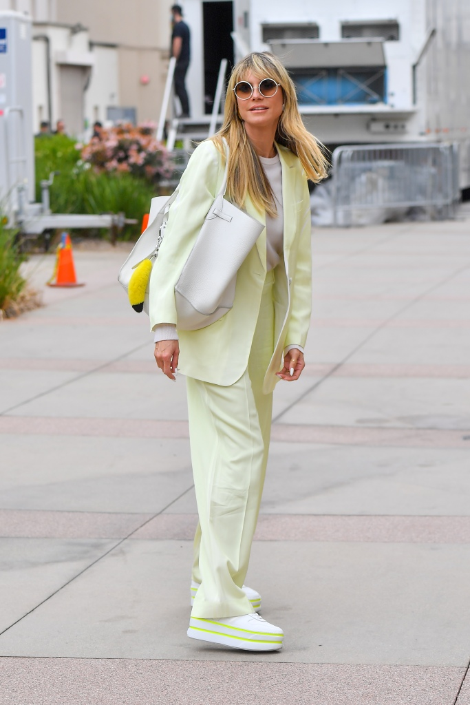Heidi Klum wears a monochromatic pastel yellow outfit as she makes her way into AGTPictured: Heidi KlumRef: SPL5223241 230421 NON-EXCLUSIVEPicture by: SplashNews.comSplash News and PicturesUSA: +1 310-525-5808London: +44 (0)20 8126 1009Berlin: +49 175 3764 166photodesk@splashnews.comWorld Rights