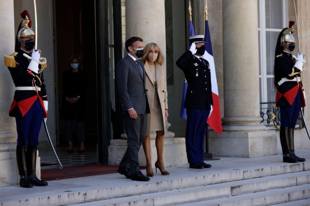 brigitte macron, heels, pumps, tights, dress, tan, coat, elysee palace, german president, louis vuitton