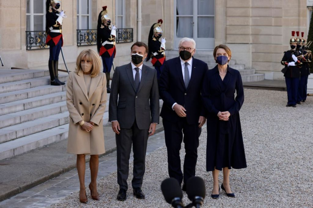 brigitte macron, heels, pumps, tights, dress, tan, coat, elysee palace, german president, louis vuitton