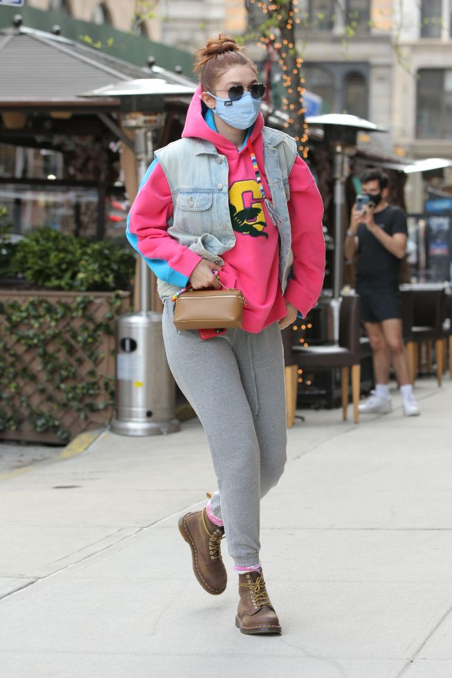 gigi hadid, sweatshirt, pink hoodie, vest, jeans, sweatpants, boots, dr martens, purse, new york