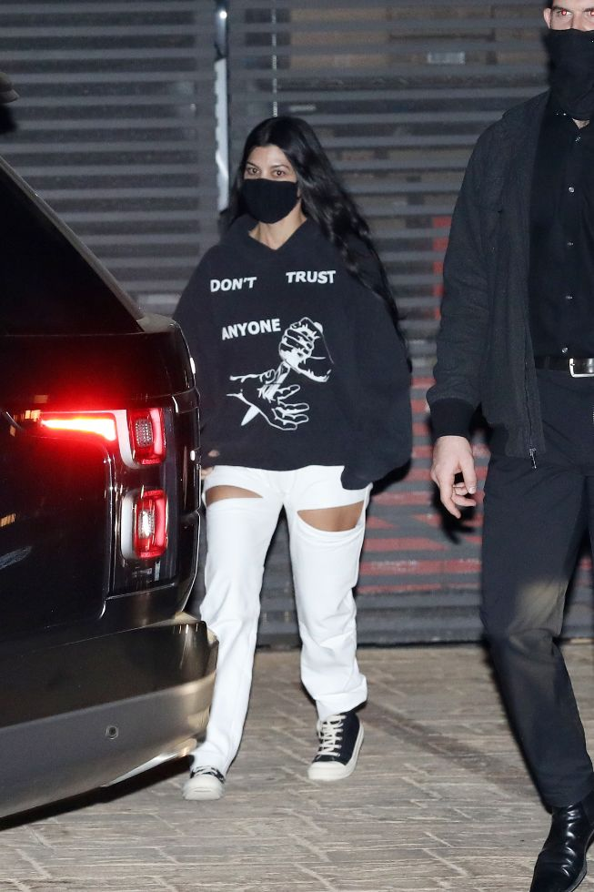 kourtney kardashian, sweatshirt, pants, cutout pants, sneakers, fear of god, nobu, mason disick, la