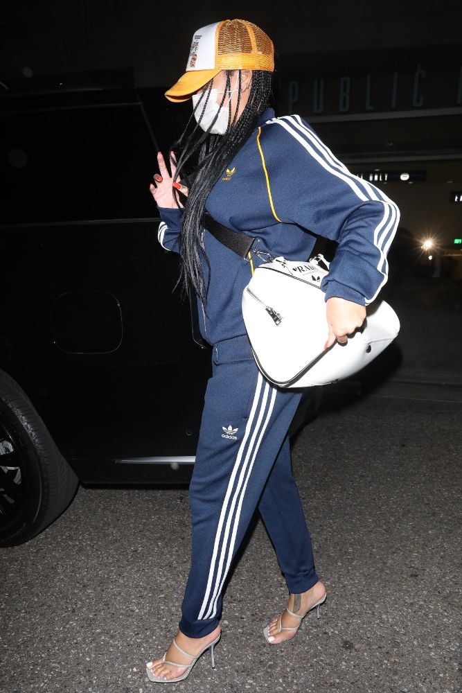 rihanna, tracksuit, prada, adidas, sweatpants, thong sandals, hat, dinner, la