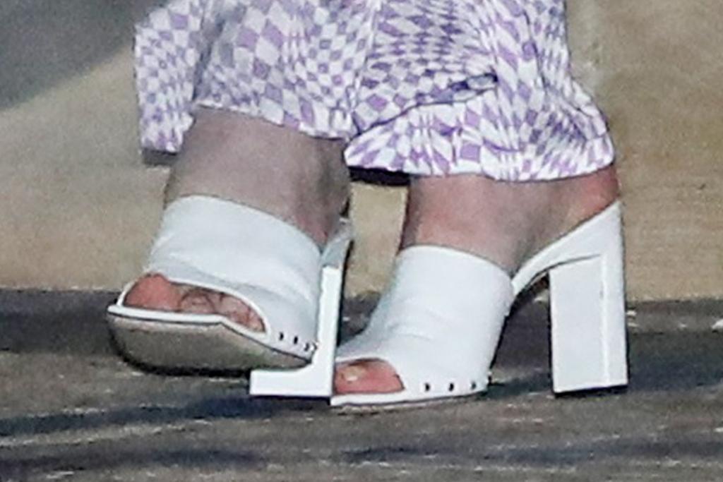 sophie turner, pajamas, bralette, silk pants, purple, heels, mules, joe jonas, dinner, date, la