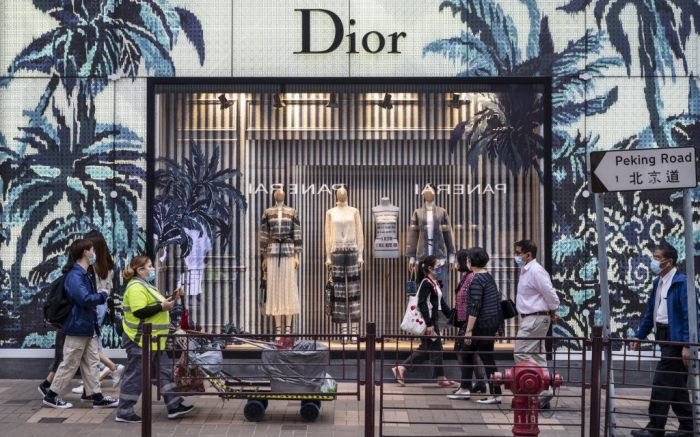 Pedestrians walk past the French Christian Dior luxury goods, clothing and beauty products store seen in Hong Kong. (Photo by Budrul Chukrut / SOPA Images/Sipa USA)(Sipa via AP Images)