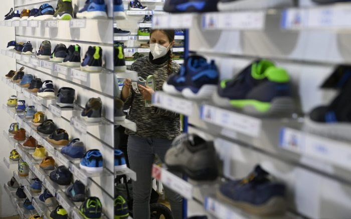 Shops with child clothing and shoes (pictured shop in Prague, Dejvice), stationer's, cleaner's, laundries, locksmith's and shops selling spare parts for motor vehicles and machines reopen in Czech Republic, April 12, 2021. Photo/Ondrej Deml (CTK via AP Images)