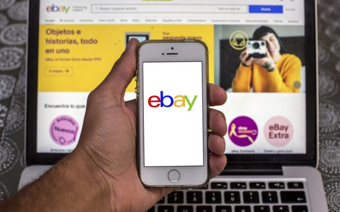 In this photo illustration an EBay App seen displayed on a smartphone with the EBay website displayed on a laptop in the background. (Photo by Thiago Prudencio / SOPA Images/Sipa USA)(Sipa via AP Images)