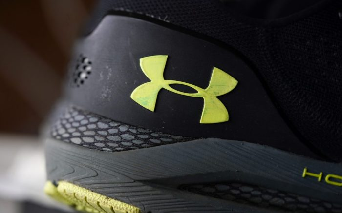 The company logo adorns the heel of a pair of HOVR Sonic running shoes at Under Armour store in an outlet mall in this photograph taken Monday, May 3, 2021, in Lakewood, Colo. (AP Photo/David Zalubowski)
