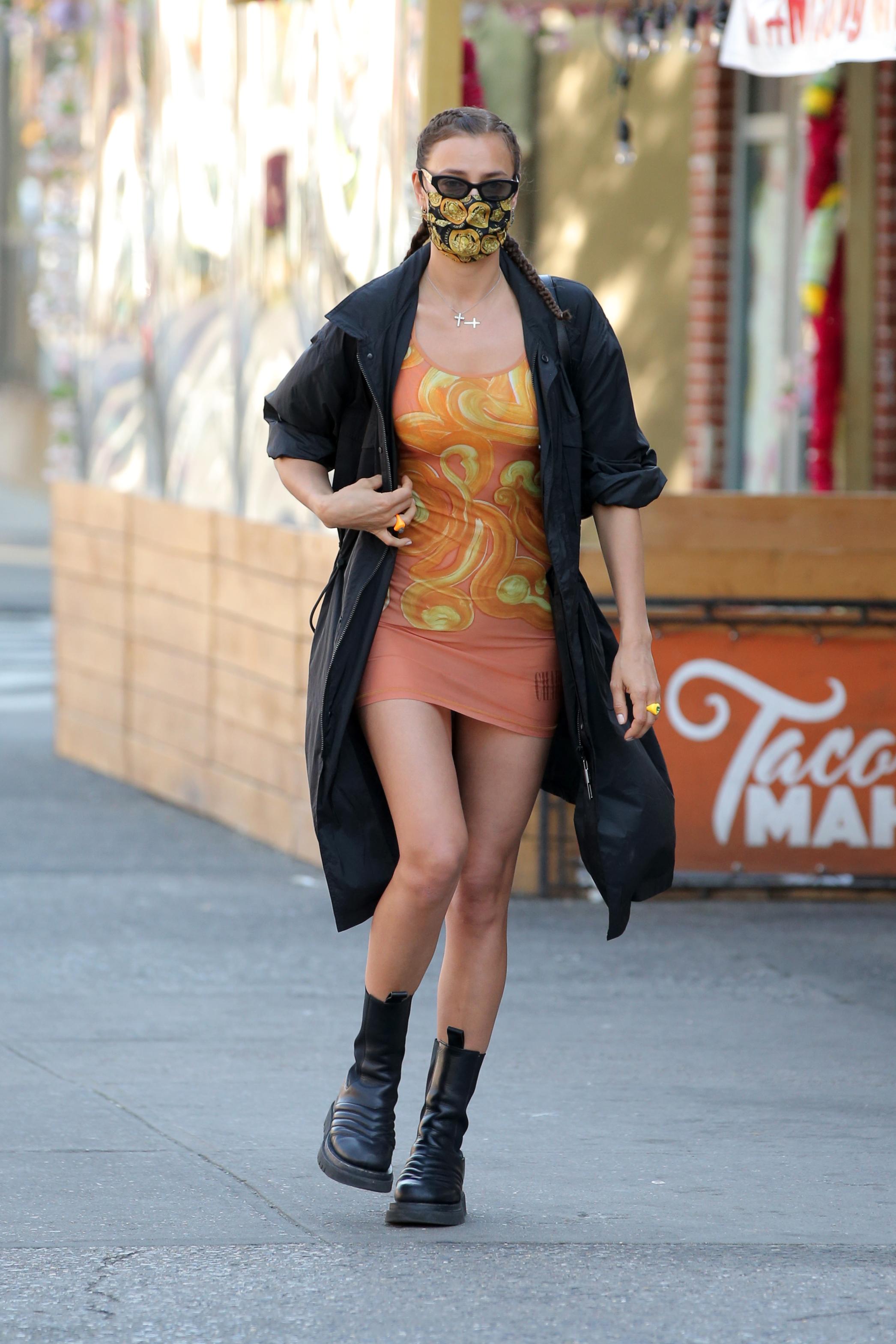 Irina Shayk, Charlotte Knowles orange dress, versace face mask, Bottega Veneta boots, trench coat