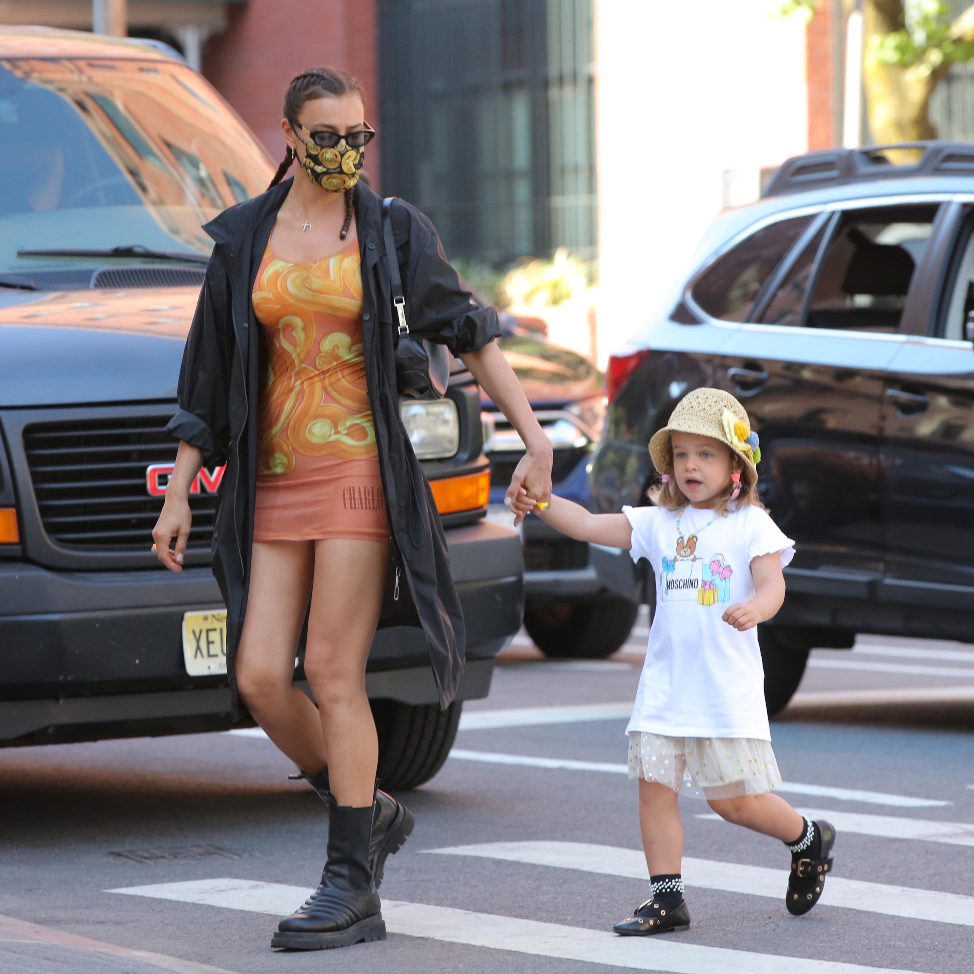 Irina Shayk and daughter Lea Cooper, Charlotte Knowles dress, bottega veneta boots, versace face mask