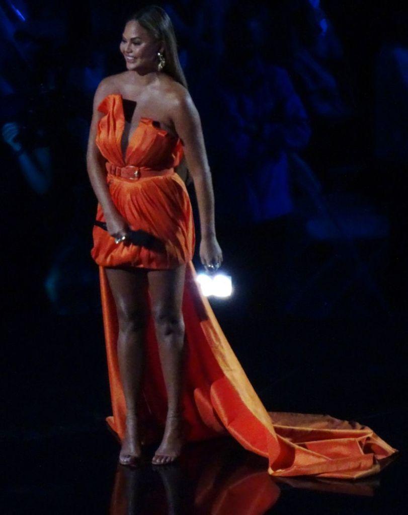 chrissy teigen, dress, orange dress, strapless, heels, ankle-wrap sandals, global citizen, vax live, concert, california