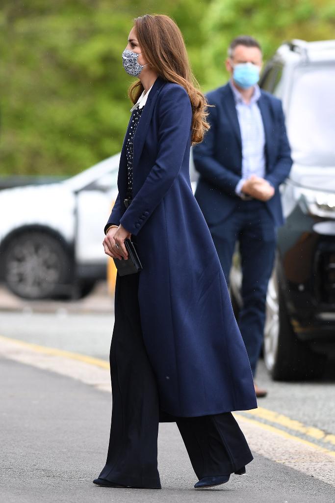 kate middleton, navy coat, pants, boots, wolverhampton