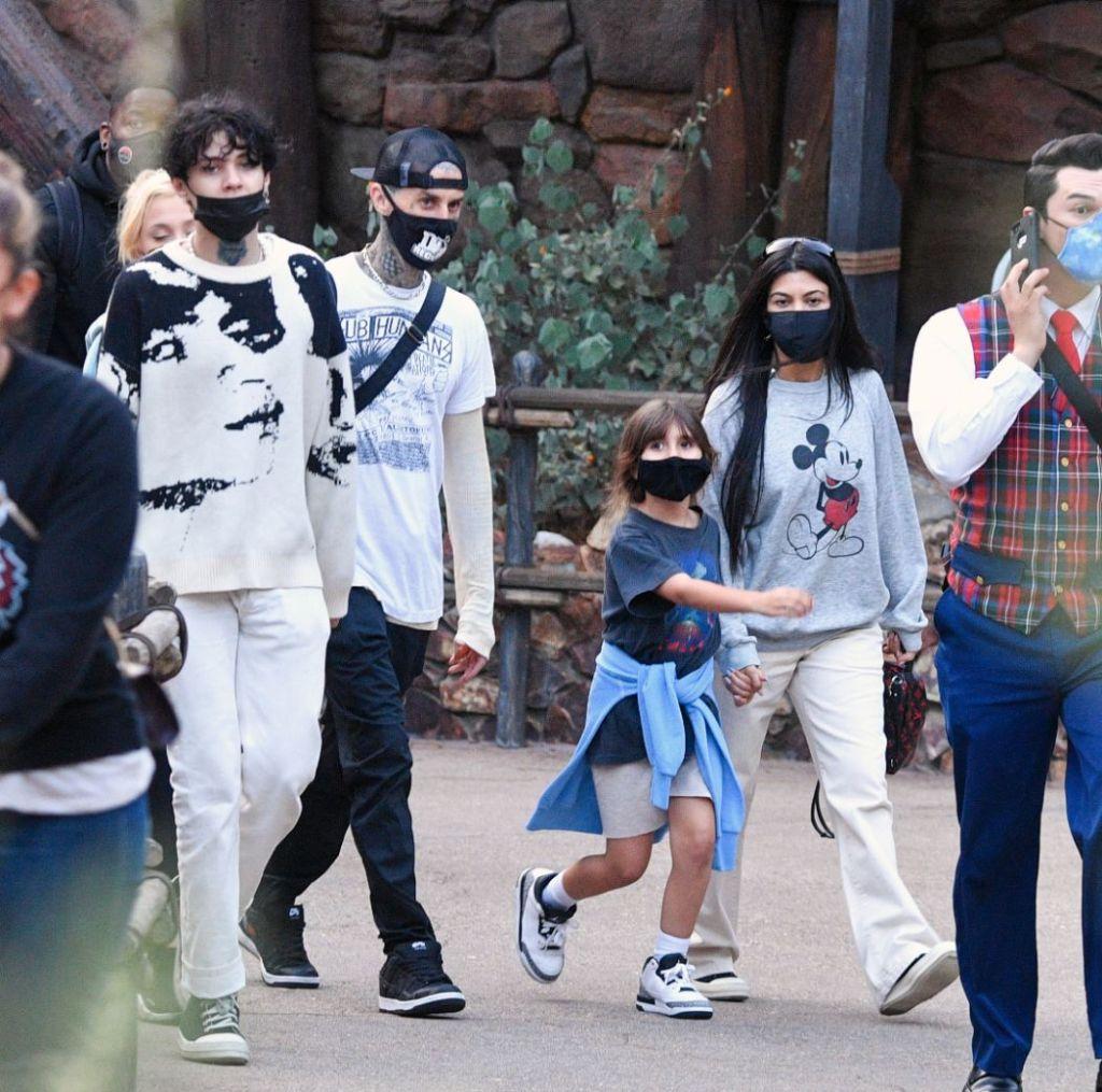 kourtney kardashian, jeans, sweatshirt, disney, disneyland, travis barker, son, daughter, california, kids
