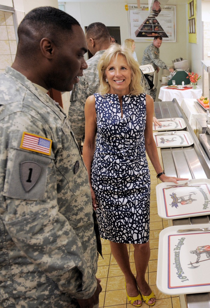 Jill Biden, wife of U.S. Vice President Joe Biden, center, talks with Garrison Command Sergeant Major Bruce Lee, left, from Rock Island, Illinois, inside a dining facility at Warner Barracks, a U.S. Army Garrison in Bamberg, southern Germany, Friday, July 3, 2009. Jill Biden visits U.S. Army Garrisons in Bamberg and Schweinfurt to celebrate the Independence Day holiday with soldiers and their family members stationed in Germany. This is part of Biden's ongoing work to raise awareness and show appreciation for members of the military and their families. (AP Photo/Jens Meyer)