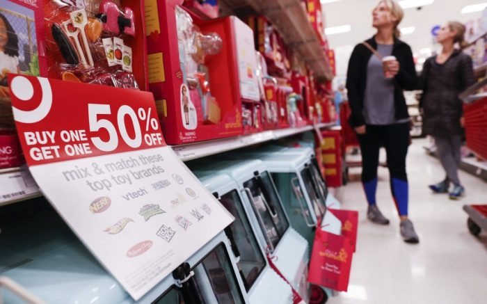 FILE- In this Nov. 23, 2018, file photo shoppers browse the aisles during a Black Friday sale at a Target store in Newport, Ky. On Wednesday, Dec. 12, the Labor Department reports on U.S. consumer prices for November. (AP Photo/John Minchillo, FIle)