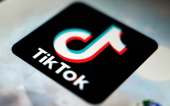 FILE - In this Sept. 28, 2020, file photo, the TikTok app logo appears in Tokyo. The founder of TikTok's Chinese owner said Thursday, May 20, 2021, he will give up his job as CEO to focus on longer-term initiatives, a step that comes amid uncertainty over whether the Biden administration will force the sale of the popular short video service's U.S. arm.  (AP Photo/Kiichiro Sato, File)