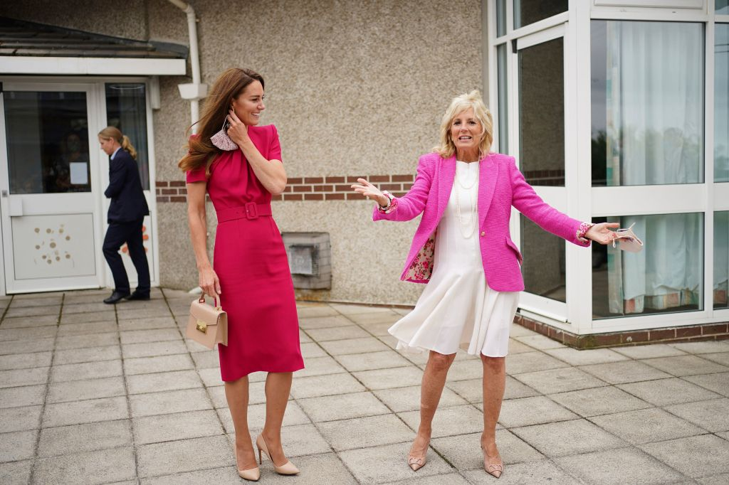 Britain's Kate, Duchess of Cambridge, left, and US First Lady Jill Biden laugh during a visit to Connor Downs Academy in Hayle, West Cornwall, during the G7 summit in England, Friday, June 11, 2021. (Aaron Chown/Pool photo via AP)