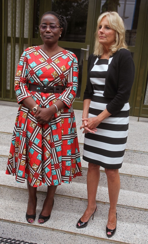 Congolese MP Jaynet Kabila, left, poses for photographers with Jill Biden, right, the wife of American Vice-President Joe Biden during a meeting in Kinshasa, Democratic Republic of Congo, Friday, July 4, 2014. Jill Biden, the wife of Vice President Joe Biden, is highlighting female empowerment, education and leadership on a tour of three African countries this week, including the DRC. (AP Photo/John Bompengo)