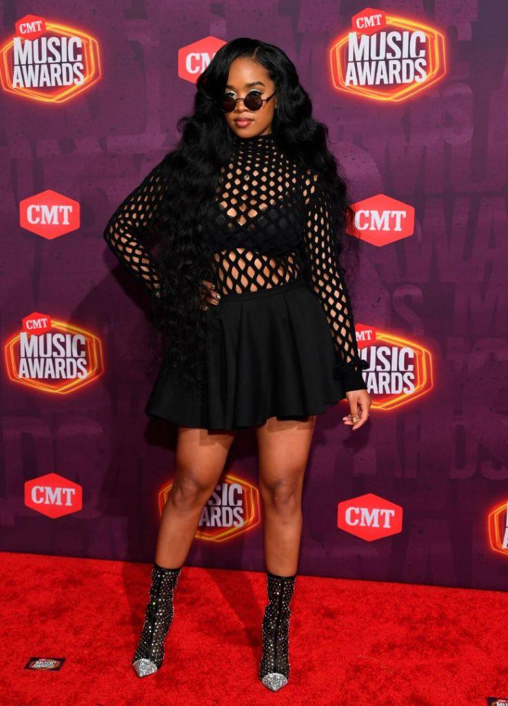 h.e.r., skirt, fishnet top, bralette, booties, cmt music awards, sunglasses, red carpet