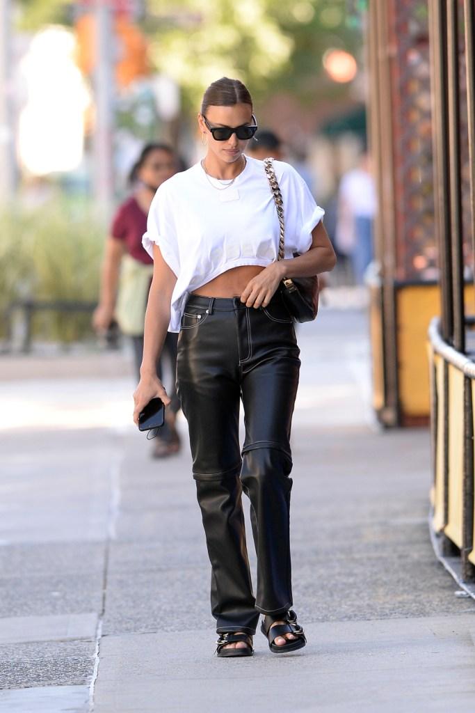 irina shayk, crop top, leather pants, sandals