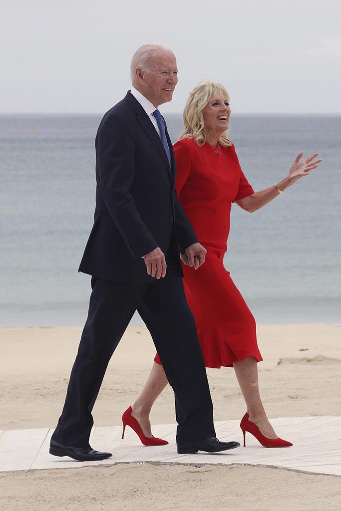 U.S. President Joe Biden and his wife Jill head for the welcome ceremony during the G7 Summit at Carbis Bay in Cornwall, United Kingdom on June 11, 2021. ( The Yomiuri Shimbun via AP Images )