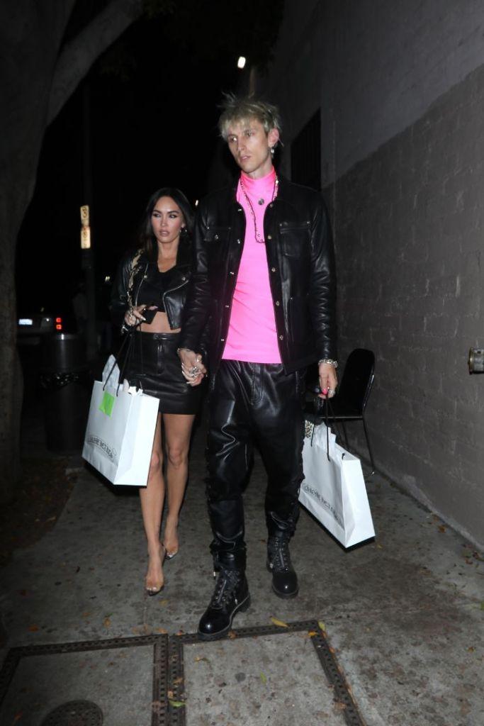 megan fox, skirt, leather skirt, leather jacket, crop top, bralette, heels, see-through heels, mgk, machine gun kelly, pink shirt, la, party