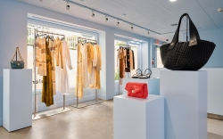 A boutique with clothing, handbags, and