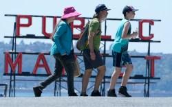 People walk near Pike Place Market,