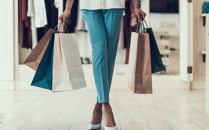 Young Girl holding Shopping Bags in Store Mall