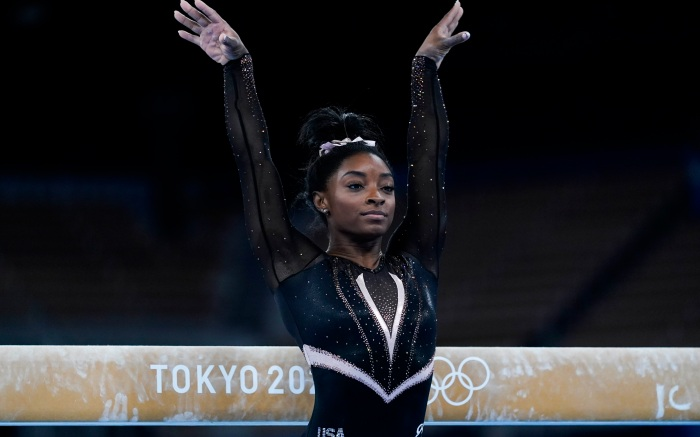 Simone Biles of the United States trains on balance beam for artistic gymnastics at Ariake Gymnastics Centre venue ahead of the 2020 Summer Olympics, Thursday, July 22, 2021, in Tokyo, Japan. (AP Photo/Ashley Landis)