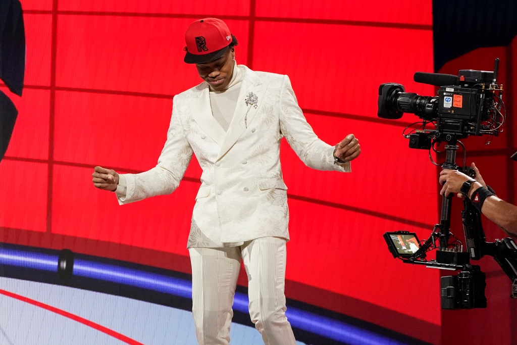 Scottie Barnes reacts after being selected fourth overall by the Toronto Raptors during the first round of the NBA basketball draft, Thursday, July 29, 2021, in New York. (AP Photo/Corey Sipkin)