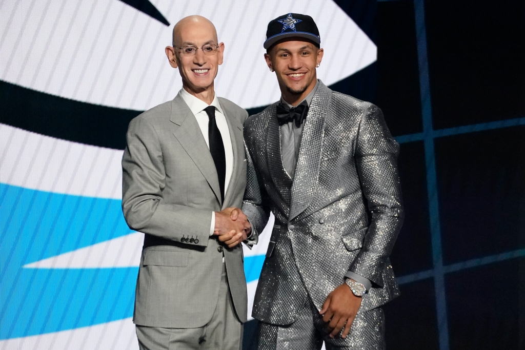 Jalen Suggs, right, poses for a photo with NBA Commissioner Adam Silver after being selected fifth overall by the Orlando Magic during the first round of the NBA basketball draft, Thursday, July 29, 2021, in New York. (AP Photo/Corey Sipkin)