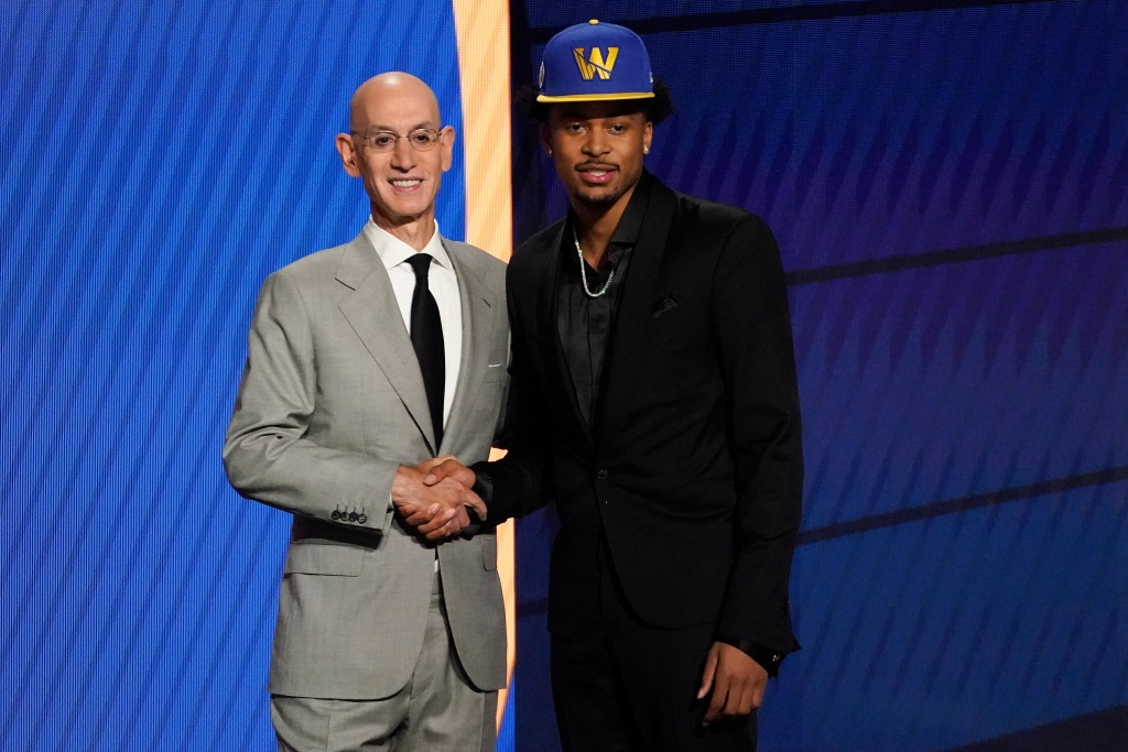 Moses Moody poses for a photo with NBA Commissioner Adam Silver after being selected 14th overall by the Golden State Warriors during the NBA basketball draft, Thursday, July 29, 2021, in New York. (AP Photo/Corey Sipkin)
