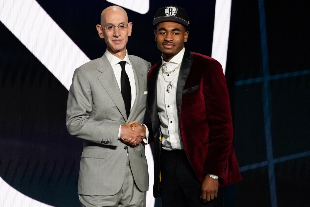 Cameron Thomas, right, poses for a photo with NBA Commissioner Adam Silver after being selected 27th overall by the Brooklyn Nets during the NBA basketball draft, Thursday, July 29, 2021, in New York. (AP Photo/Corey Sipkin)