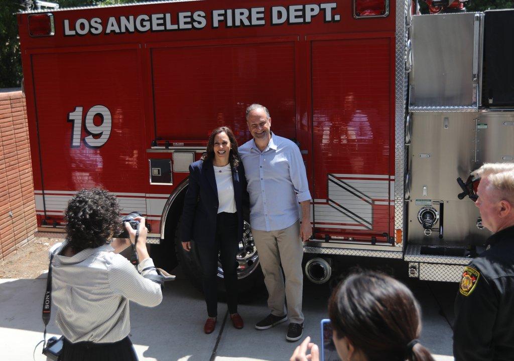 United States Vice President Kamala Harris and her husband Second Gentleman Douglas Emhoff make a surprise visit to LAFD 19 station in the Brentwood neighborhood of Los Angeles, California, United States as part of the holiday celebration on 04 July 2021. In 2019, the crew of Station 19 were part of more than 1,000 firefighters who battled the Getty fire in Los Angeles.  Credit: David Swanson / Pool via CNP.  July 04, 2021 Pictured: United States Vice President Kamala Harris and her husband Second Gentleman Douglas Emhoff make a surprise visit to LAFD Station 19 in the Brentwood neighborhood of Los Angeles, California, USA as part of the holiday celebration July 04, 2021. In 2019, the crew of Station 19 were among more than 1,000 firefighters who battled the Getty fire in Los Angeles.  Credit: David Swanson / Pool via CNP.  Photo Credit: David Swanson - Pool via CNP / MEGA TheMegaAgency.com +1 888 505 6342 (Mega Agency TagID: MEGA767583_007.jpg) [Photo via Mega Agency]