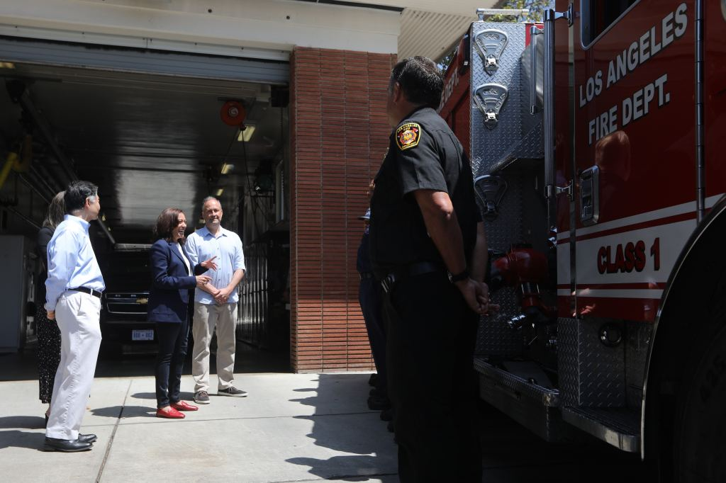 United States Vice President Kamala Harris and her husband Second Gentleman Douglas Emhoff make a surprise visit to LAFD 19 station in the Brentwood neighborhood of Los Angeles, California, United States as part of the holiday celebration on 04 July 2021. In 2019, the crew of Station 19 were part of more than 1,000 firefighters who battled the Getty fire in Los Angeles.  Credit: David Swanson / Pool via CNP.  July 04, 2021 Pictured: United States Vice President Kamala Harris and her husband Second Gentleman Douglas Emhoff make a surprise visit to LAFD Station 19 in the Brentwood neighborhood of Los Angeles, California, USA as part of the holiday celebration July 04, 2021. In 2019, the crew of Station 19 were among more than 1,000 firefighters who battled the Getty fire in Los Angeles.  Credit: David Swanson / Pool via CNP.  Photo credit: David Swanson - Pool via CNP / MEGA TheMegaAgency.com +1 888 505 6342 (Mega Agency TagID: MEGA767583_009.jpg) [Photo via Mega Agency]