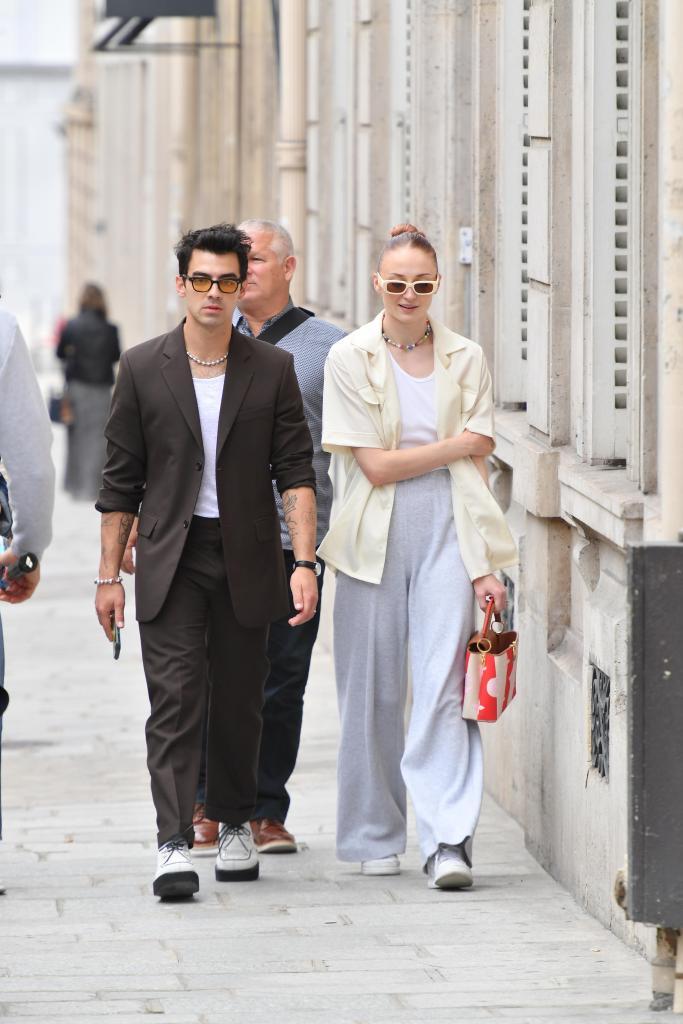 "Joe Jonas and his wife Sophie Turner go for a walk during Paris Fashion week. They had lunch at ""l'avenue"" and stopped to buy Cuban cigars. 08 Jul 2021 Pictured: Joe Jonas and Sophie Turner. Photo credit: KCS Presse / MEGA TheMegaAgency.com +1 888 505 6342 (Mega Agency TagID: MEGA768760_005.jpg) [Photo via Mega Agency]"