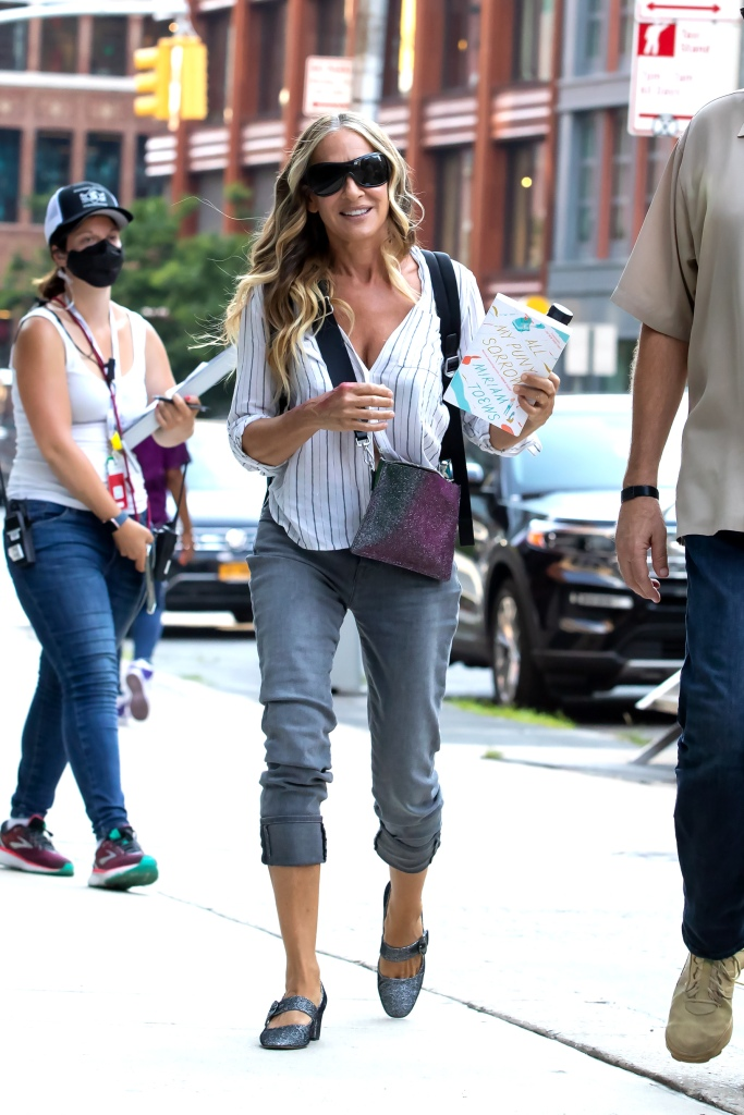 """Sarah Jessica Parker Heads to Set of """"And Just Like That"""" Sarah had some red spots on both arms, unclear whether it was makeup. Was reading """"All My Puny Sorrows"""" by Miriam Toews. Downtown, NY. 16 Jul 2021 Pictured: Sarah Jessica Parker. Photo credit: RCF / MEGA TheMegaAgency.com +1 888 505 6342 (Mega Agency TagID: MEGA771760_002.jpg) [Photo via Mega Agency]"""