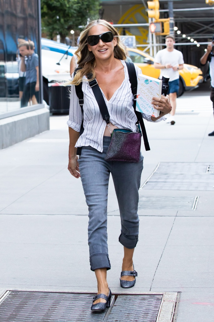 """Sarah Jessica Parker Heads to Set of """"And Just Like That"""" Sarah had some red spots on both arms, unclear whether it was makeup. Was reading """"All My Puny Sorrows"""" by Miriam Toews. Downtown, NY. 16 Jul 2021 Pictured: Sarah Jessica Parker. Photo credit: RCF / MEGA TheMegaAgency.com +1 888 505 6342 (Mega Agency TagID: MEGA771760_003.jpg) [Photo via Mega Agency]"""