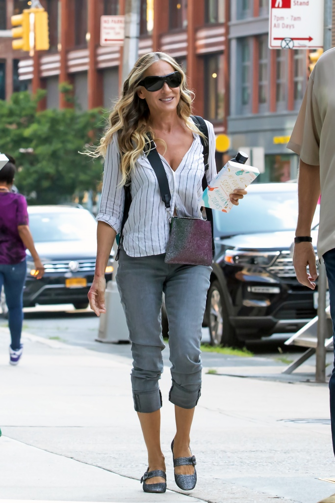 """Sarah Jessica Parker Heads to Set of """"And Just Like That"""" Sarah had some red spots on both arms, unclear whether it was makeup. Was reading """"All My Puny Sorrows"""" by Miriam Toews. Downtown, NY. 16 Jul 2021 Pictured: Sarah Jessica Parker. Photo credit: RCF / MEGA TheMegaAgency.com +1 888 505 6342 (Mega Agency TagID: MEGA771760_008.jpg) [Photo via Mega Agency]"""