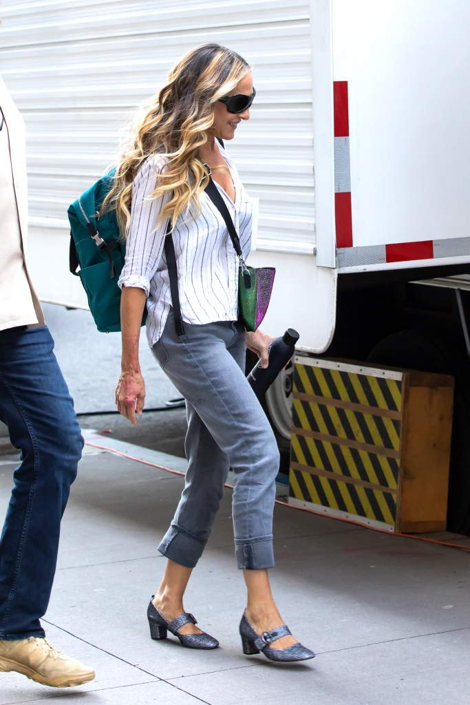 """Sarah Jessica Parker Heads to Set of """"And Just Like That"""" Sarah had some red spots on both arms, unclear whether it was makeup. Was reading """"All My Puny Sorrows"""" by Miriam Toews. Downtown, NY. 16 Jul 2021 Pictured: Sarah Jessica Parker. Photo credit: RCF / MEGA TheMegaAgency.com +1 888 505 6342 (Mega Agency TagID: MEGA771760_011.jpg) [Photo via Mega Agency]"""