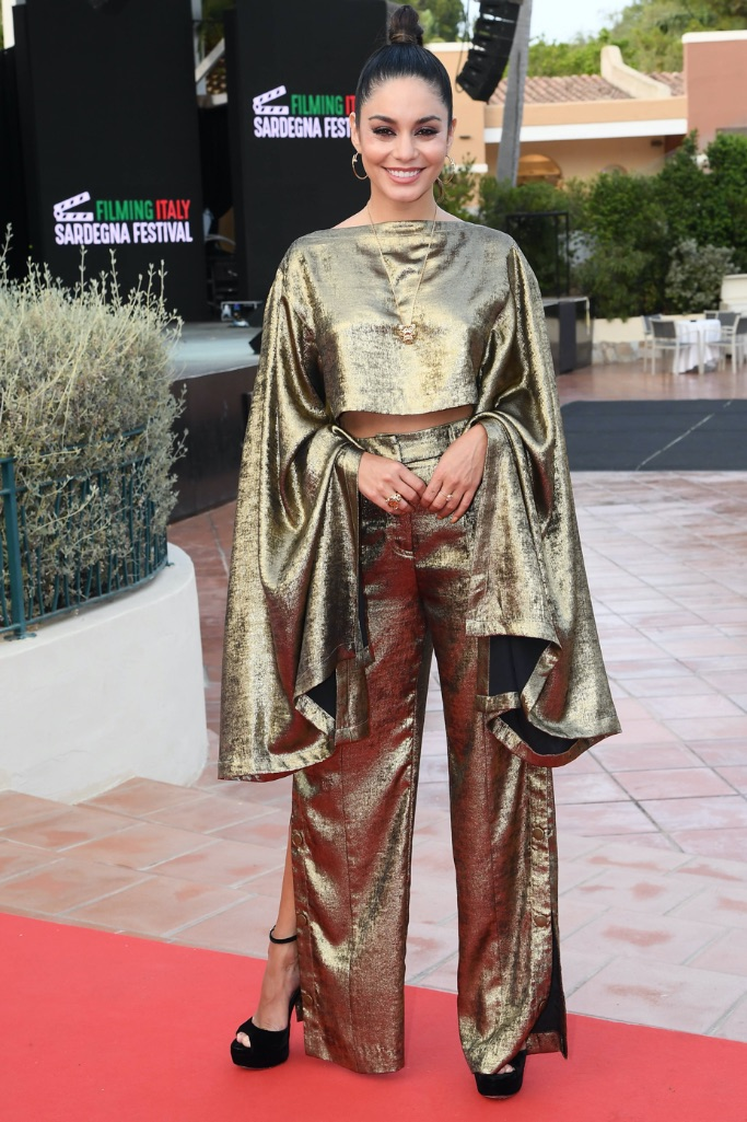 Vanessa Hugens, gold statement sleeve, pants, black platform heels, Italy