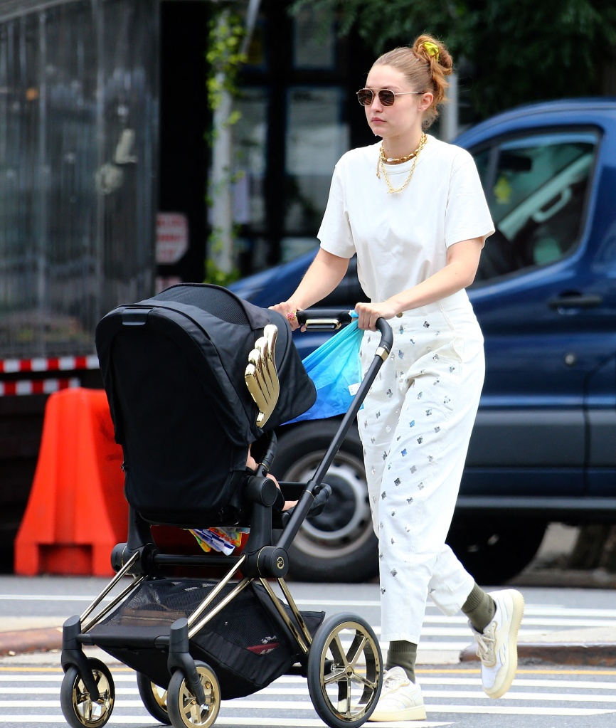 Model Gigi Hadid with her daughter and friend are strolling in Soho, New York City, NY, USA, on July 28, 2021. Photo by Dylan Travis/ABACAPRESS.COMPictured: Gigi HadidRef: SPL5241973 280721 NON-EXCLUSIVEPicture by: AbacaPress / SplashNews.comSplash News and PicturesUSA: +1 310-525-5808London: +44 (0)20 8126 1009Berlin: +49 175 3764 166photodesk@splashnews.comUnited Arab Emirates Rights, Australia Rights, Bahrain Rights, Canada Rights, Greece Rights, India Rights, Israel Rights, South Korea Rights, New Zealand Rights, Qatar Rights, Saudi Arabia Rights, Singapore Rights, Thailand Rights, Taiwan Rights, United Kingdom Rights, United States of America Rights
