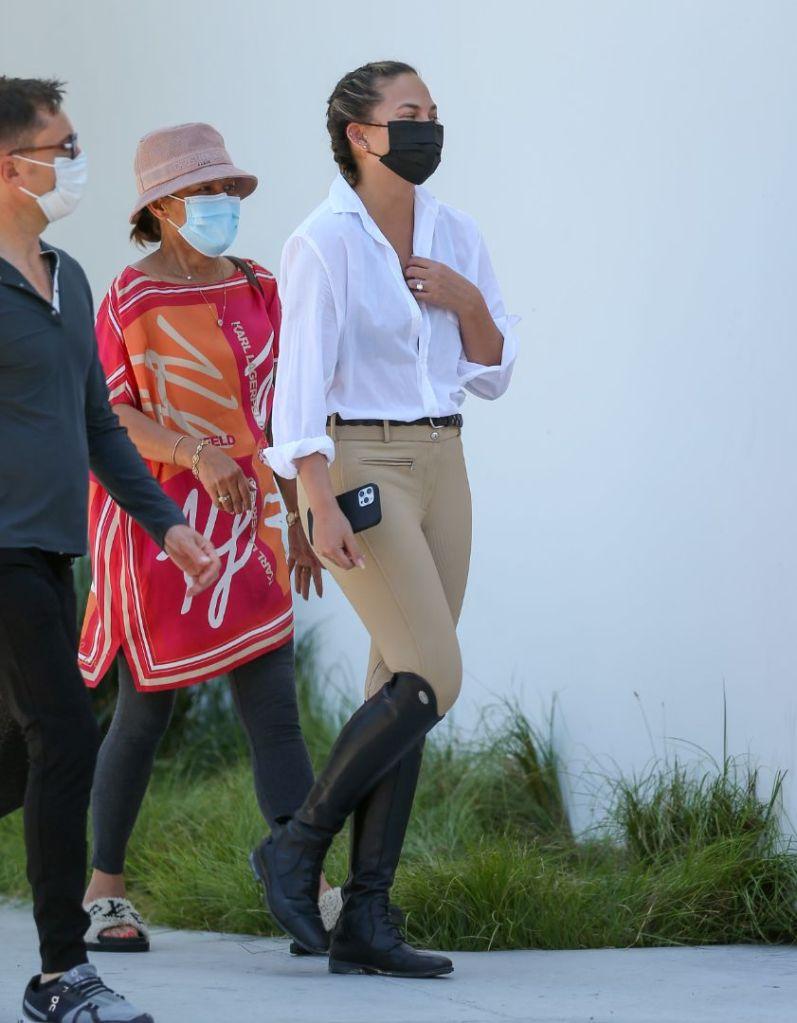 chrissy teigen, blouse, pants, riding boots, knee-high boots, horseback ride, los angeles, shopping, mom
