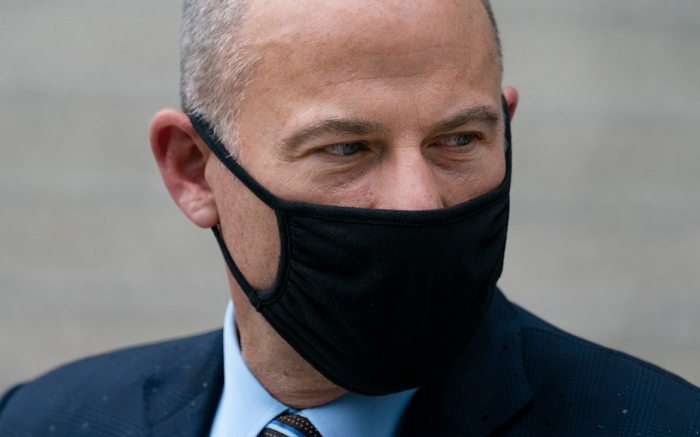 Michael Avenatti departs a scheduled sentencing at Manhattan federal court, Thursday, July 8, 2021, in New York. A New York judge has sentenced the combative California lawyer Avenatti to 2 1/2 years in prison for trying to extort up to $25 million from Nike. U.S. District Judge Paul G. Gardephe announced the sentence Thursday in Manhattan, where a jury in early 2020 convicted Avenatti of charges including attempted extortion and fraud. (AP Photo/John Minchillo)