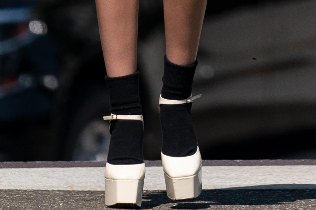 olivia rodrigo, jacket, giuseppe zanotti platforms, skirt, plaid skirt, heels, socks, platforms, white house, joe biden, video